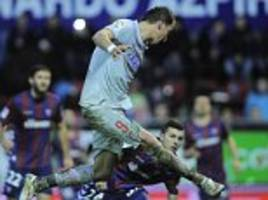 Eibar 1-3 Atletico Madrid: Mario Mandzukic grabs a brace as champions move level on points with Barcelona